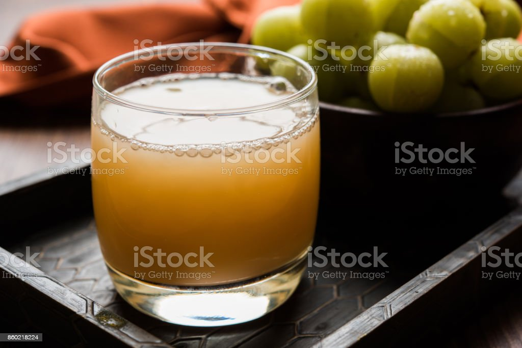 Indian fresh gooseberry juice or stock photo of Amla juice (Phyllanthus emblica) , selective focus stock photo