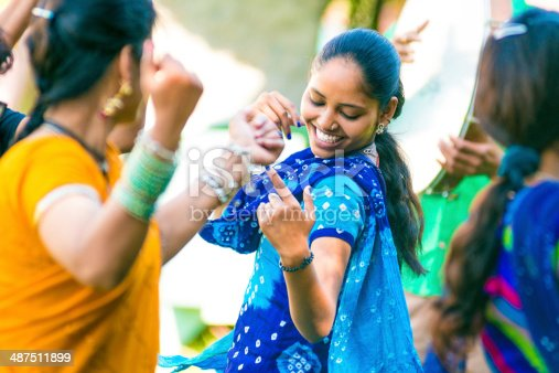Young indian woman dancing with friends