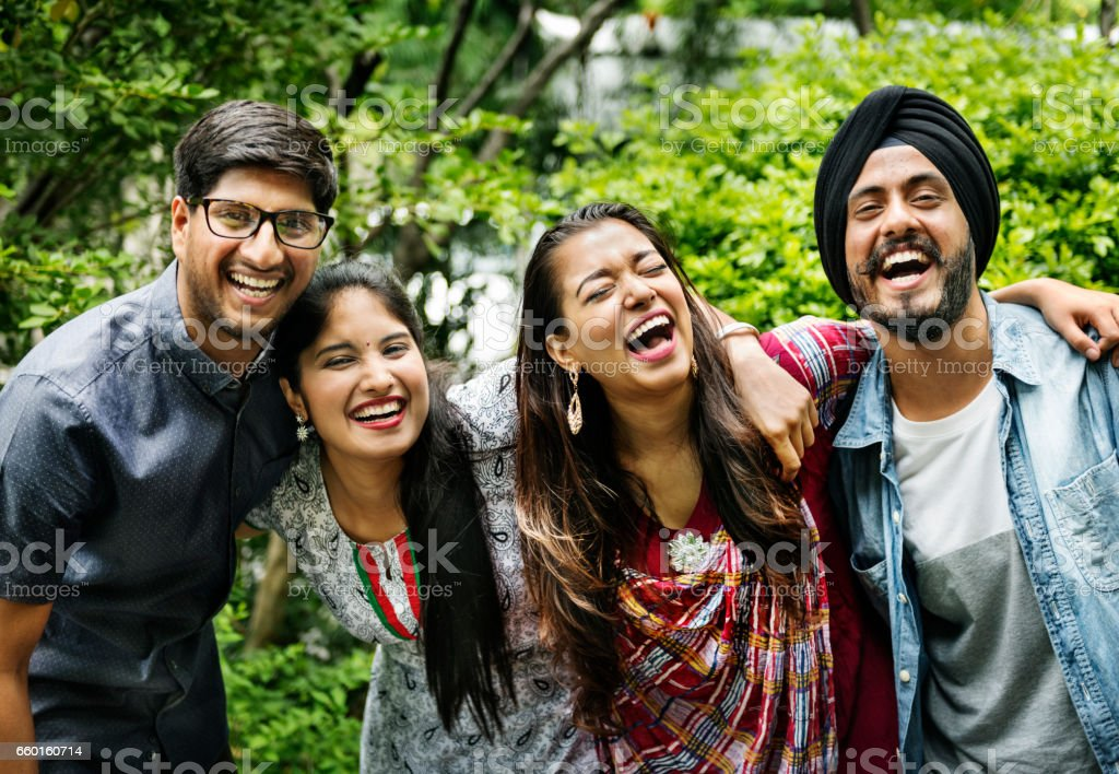 Indian Friends Hangout Outdoors Happy Concept stock photo