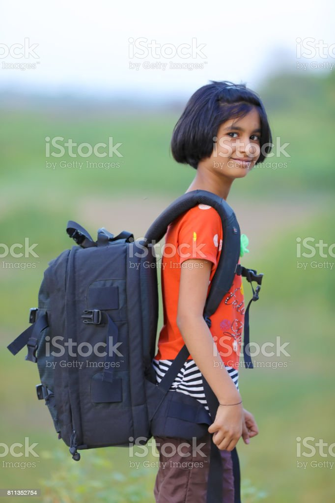 Indian girl child With Bag stock photo