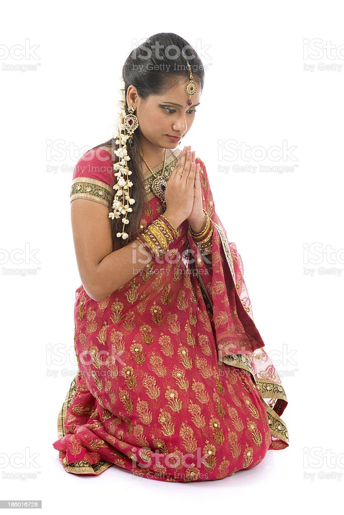 Indian girl in a praying position royalty-free stock photo