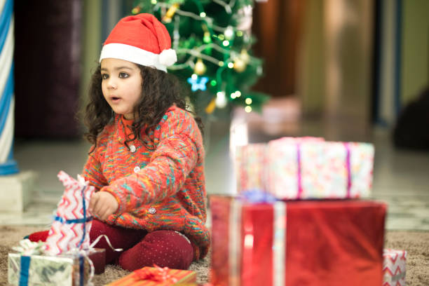 6e6d795eaa7 originalwide girl indian hat wallpapers  indian girl in santa hat holding  christmas gift stock photo more pictures of 4 5 years