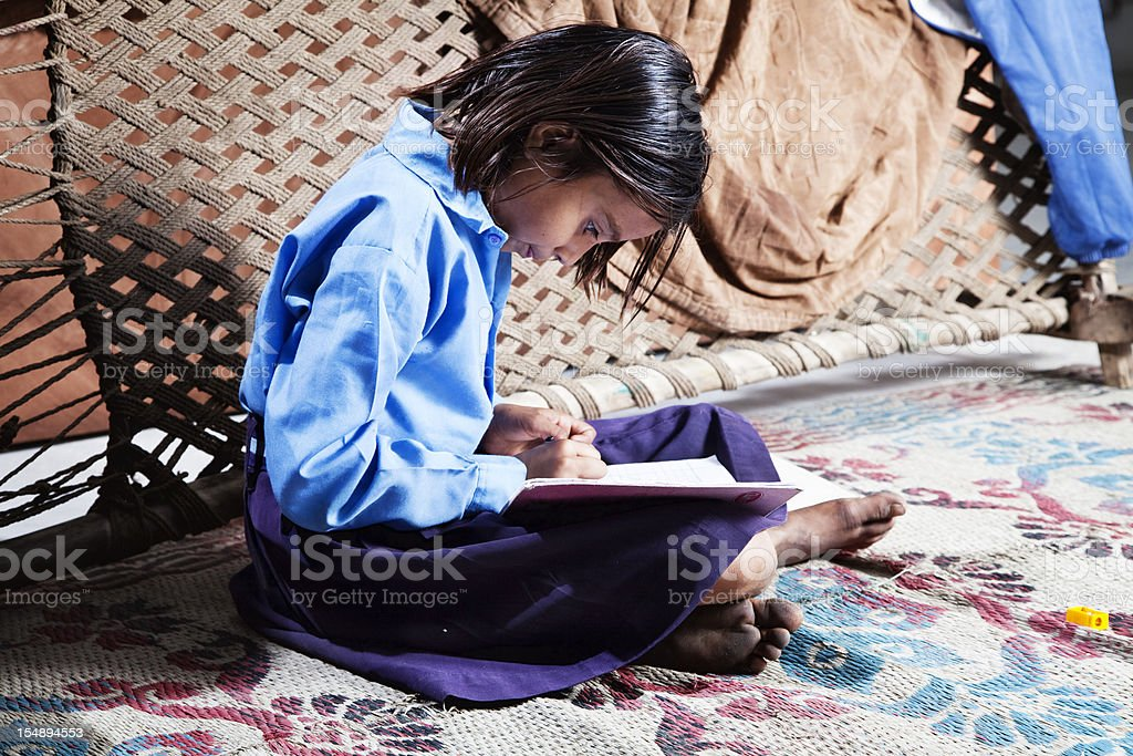 indian girl learning royalty-free stock photo