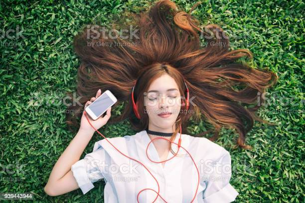 Indian girl listening to music streaming with headphones from in on picture id939443944?b=1&k=6&m=939443944&s=612x612&h=bb3ppwqm8boqkxggz5ygxndahljutqygoen20dptzz4=