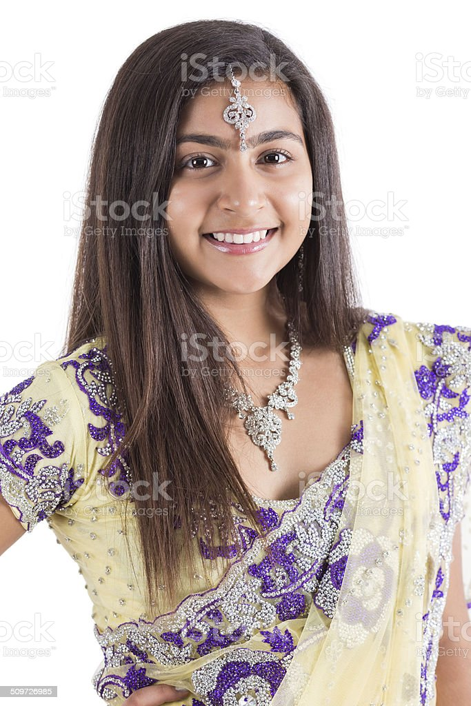 Indian Girl Smiling While Wearing Traditional Sari And Jewelry Royalty Free Stock Photo