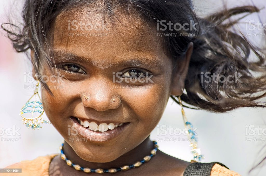 Indian girl wearing earring and hair blowing in the wind stock photo