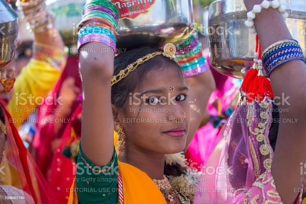 Indian girl wearing traditional Rajasthani dress participate in Desert Festival in Jaisalmer, Rajasthan, India stock photo