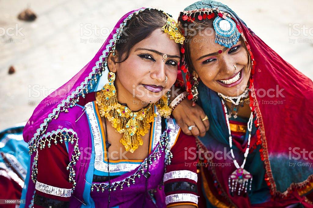Indian Girls Smiling in Rajasthan Desert stock photo