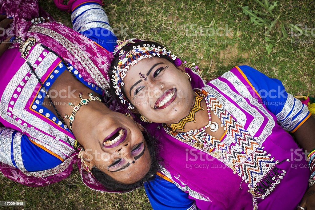 Indian Girls Smiling on grass stock photo