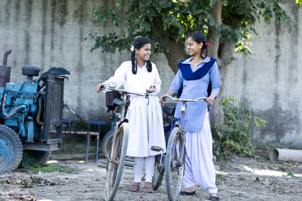 Indian girls with bicycle stock photo