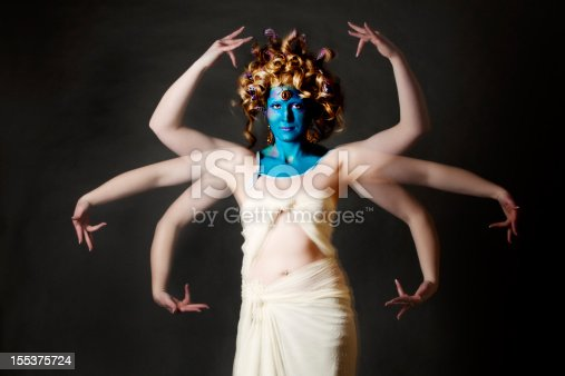 istock Indian goddess: blue-faced mystical creature with multiple arms 155375724