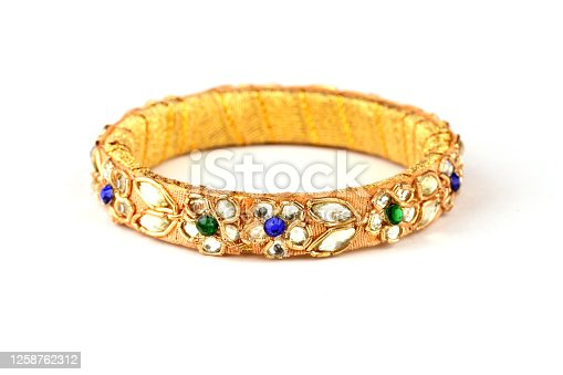 Indian golden Bangles. Bracelet with diamonds and stones on a white background, Indian Traditional Jewellery,Style, fashion and design of jewelry