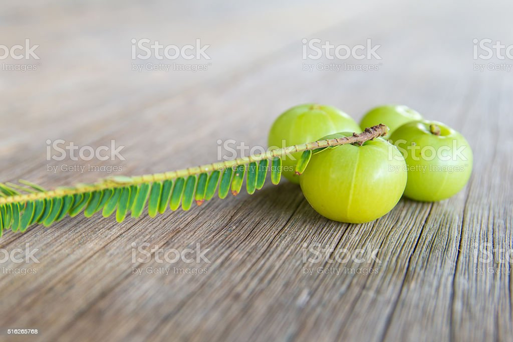 Indian gooseberries on wood floor stock photo
