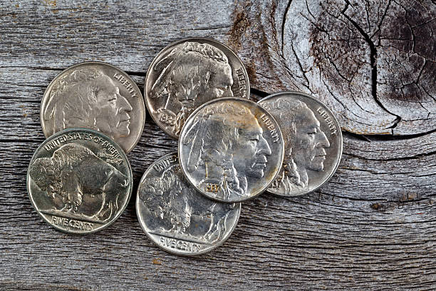 indian head coins on wood - nickel stock photos and pictures