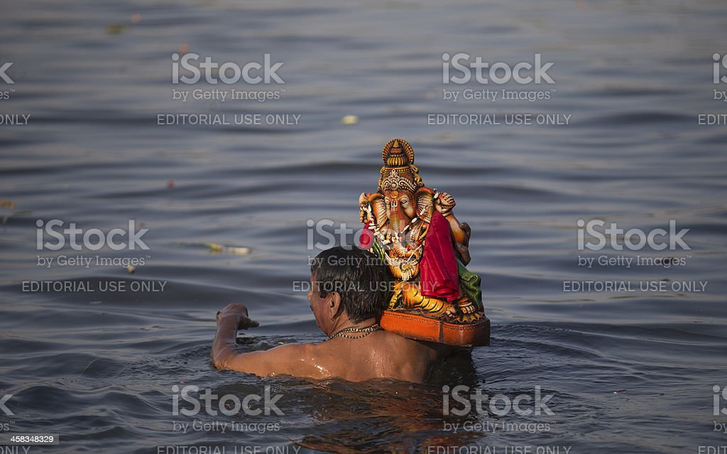 Indian Hindu Devotees carry Ganesh Idol royalty-free stock photo