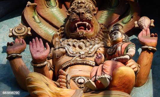 istock Indian Hindu God Narasimha avatar of god Vishnu on  wall of temple 683898290