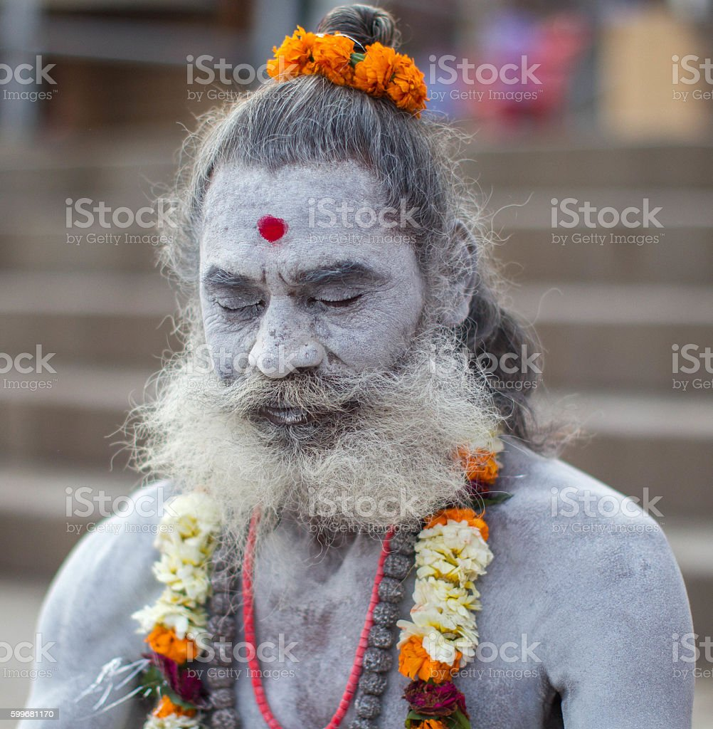 Indian Holy man meditating at Varanasi, India. stock photo