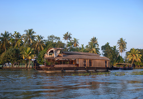 Indian houseboat floating in backwaters in Alleppey, Kerala, South India