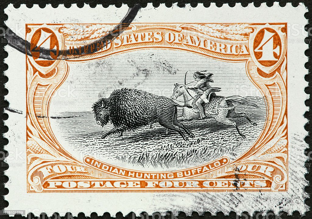 Indian hunting buffalo from a horse stock photo
