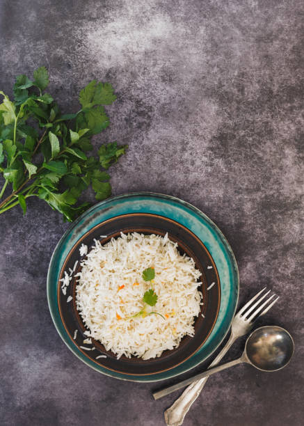 Indian jeera cumin flavoured rice Indian cumin jeera cashew pulao rice. served in rustic bowl on tray.  Top view, blank space basmati rice stock pictures, royalty-free photos & images