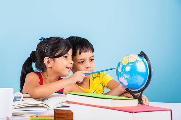 indian kids studying on study table - foto de stock
