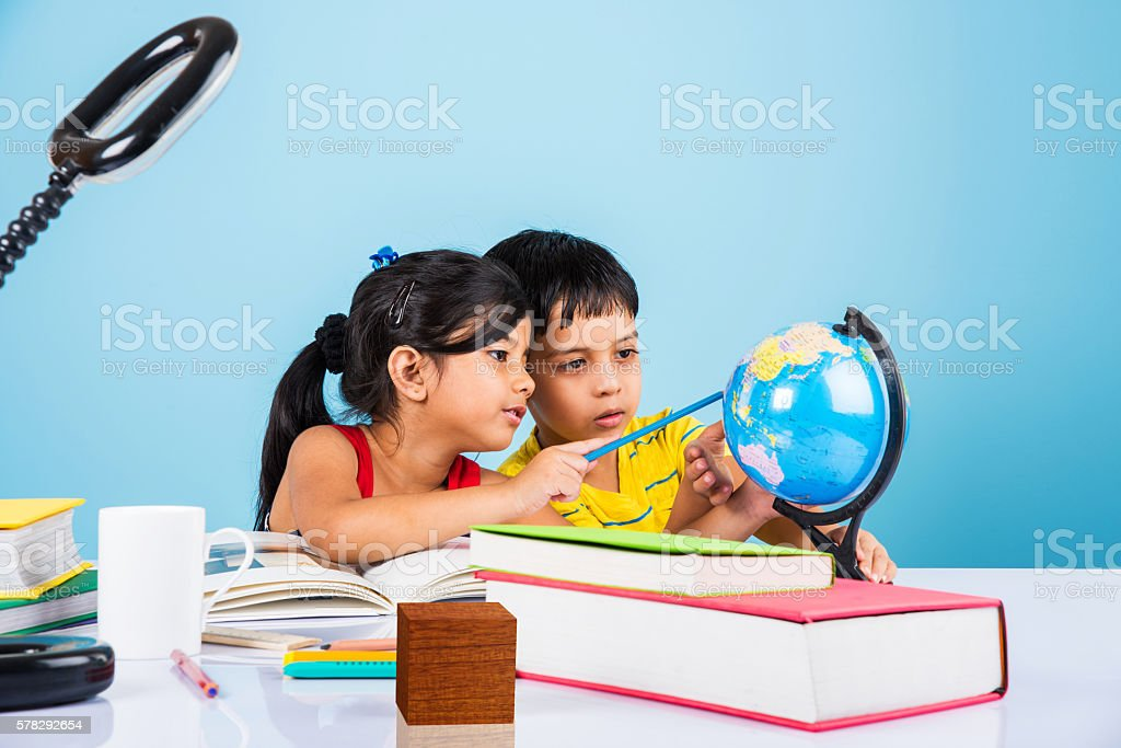 indian kids studying on study table stock photo more pictures of