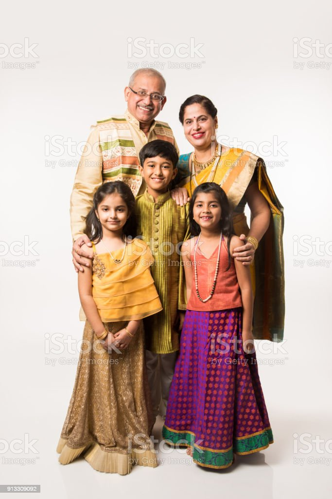 22427fe7662a Indian Kids With Grandparents In Traditional Wear Holding Gifts ...