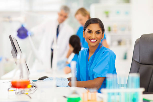 indian laboratory worker using computer stock photo