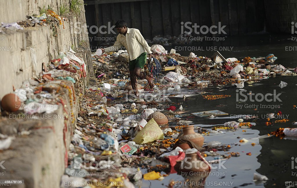 Indian labourer collects trash stock photo