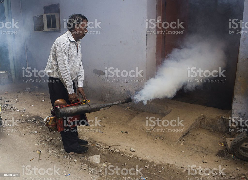 Indian labourer fumagates stock photo