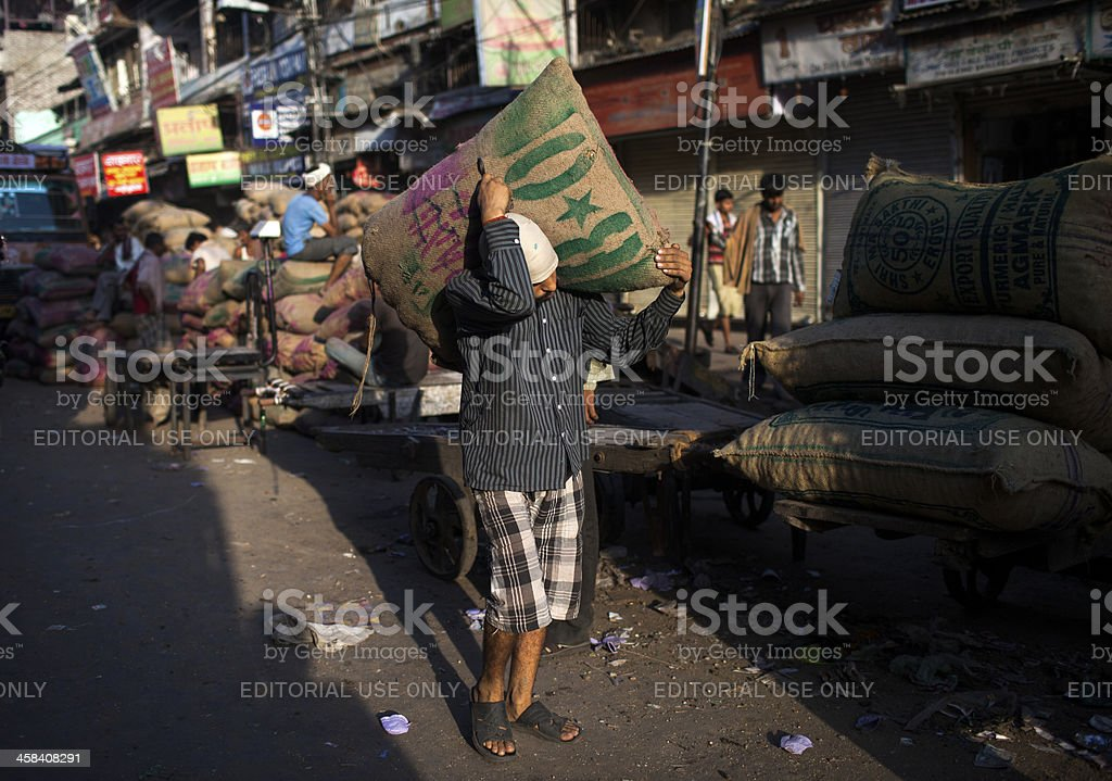 Indian labourers carry sacks royalty-free stock photo