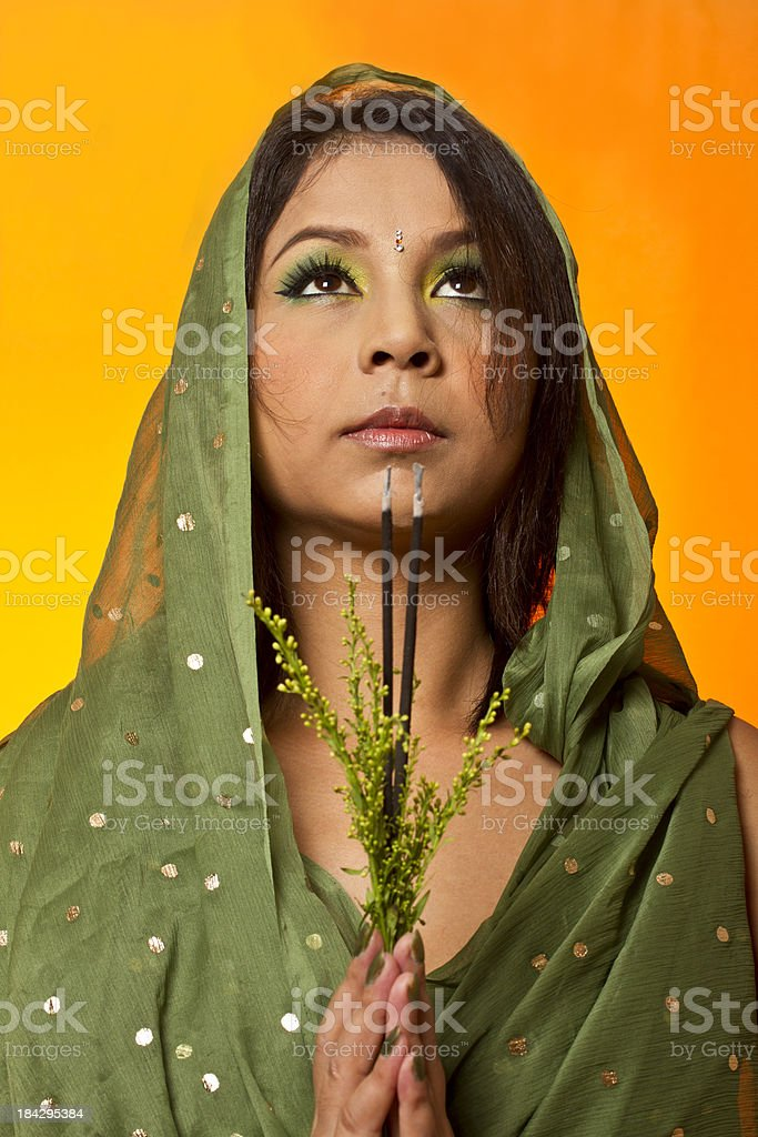 Indian lady praying royalty-free stock photo
