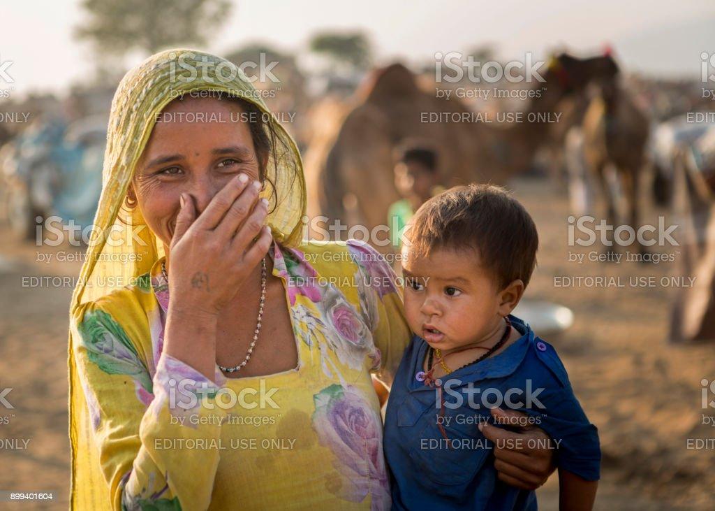 indian lady with kid  in pushkar fair stock photo