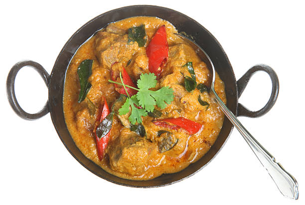 Indian Lamb Korma Curry Indian lamb curry in an authetic balti dish balti dish stock pictures, royalty-free photos & images