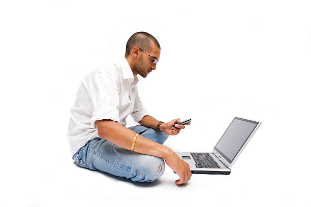 Indian Laptop Phone Man stock photo