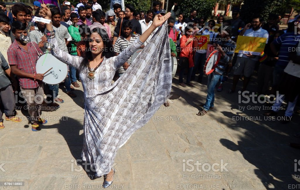 Indian LGBT activist dancing in the march demanding equality during Queer Swabhimana Yatra 2017 royalty-free stock photo