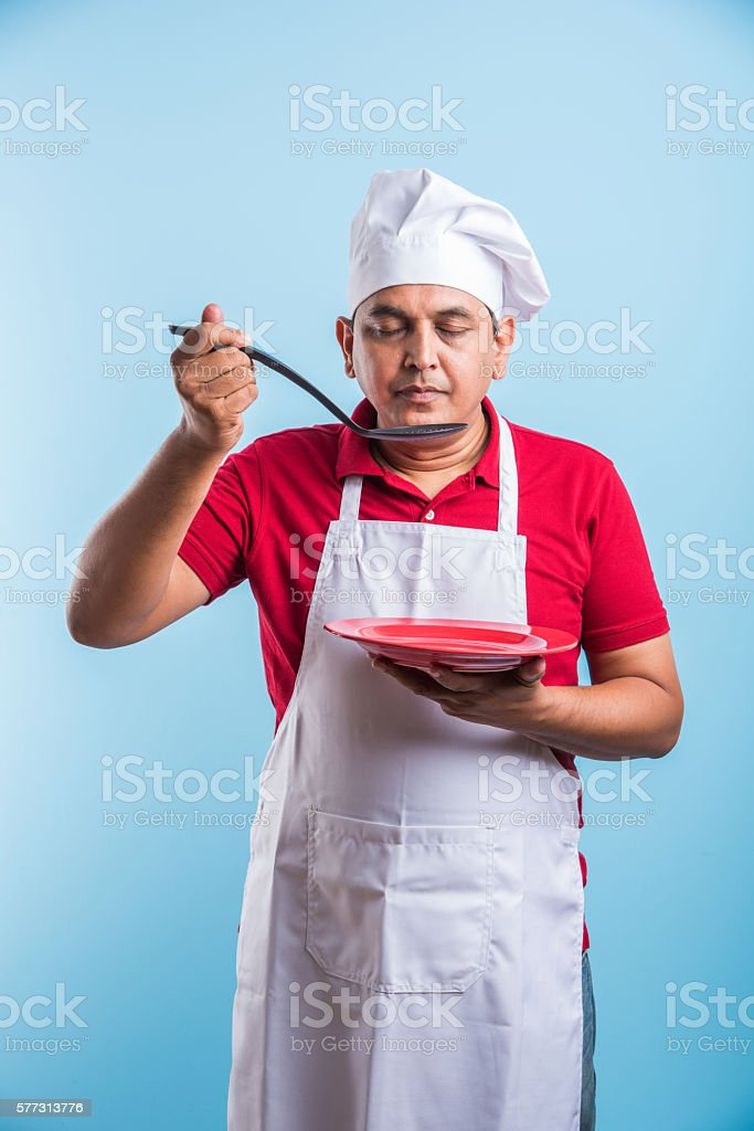 indian male chef cook tasting food stock photo