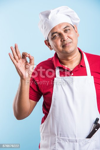 istock indian male chef showing ok sign 576576222