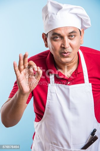 istock indian male chef showing ok sign 576576454