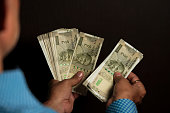 istock Indian Male Counting Cash Of Indian Five Hundred Rupees 1186111718