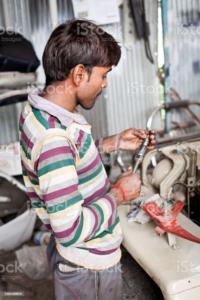 Indian Male Manual Worker Car Mechanic at Garage royalty-free stock photo