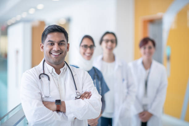 Indian male medical student smiling at camera stock photo