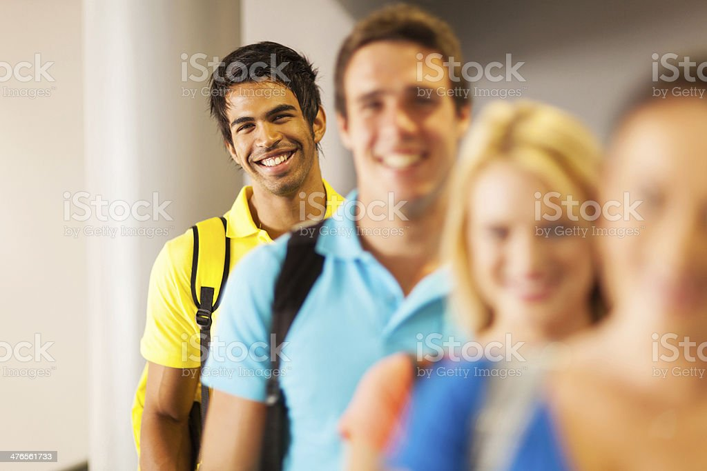 indian male student standing in a row stock photo