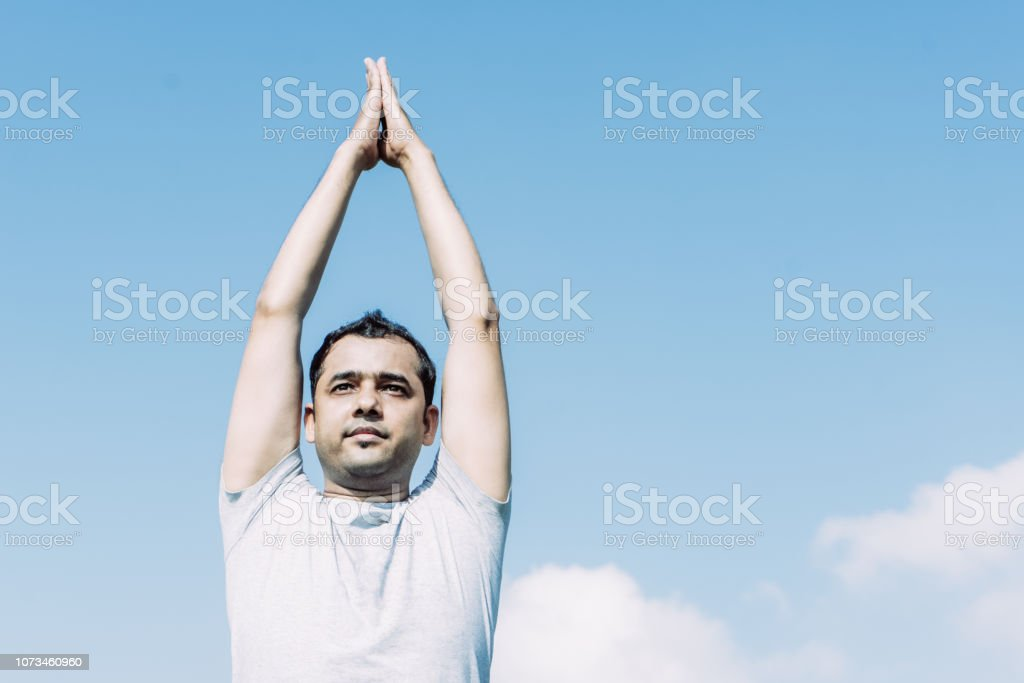 Indian Man Doing Yoga And Pressing Hands Together Above Head Stock Photo Download Image Now Istock