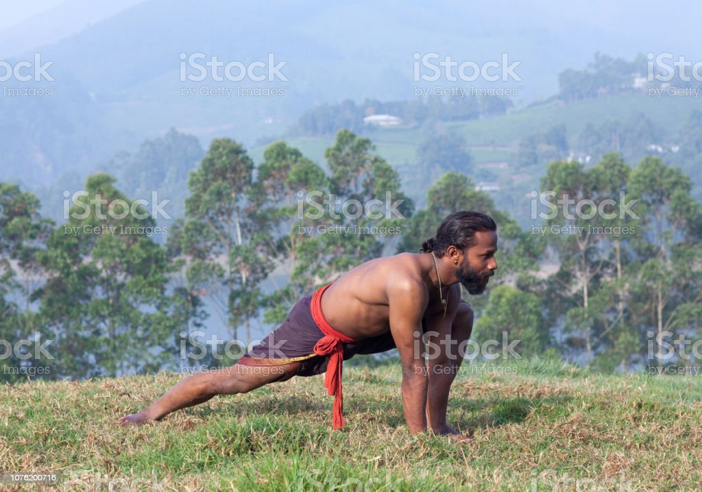 Indian Man Doing Yoga Exercises On Green Grass Stock Photo Download Image Now Istock