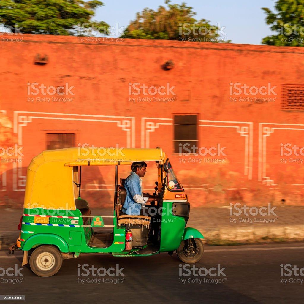 Indian man drives auto rickshaw (tuk-tuk), India stock photo