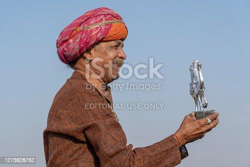 istock Indian man during Pushkar Camel Mela, Rajasthan, India, close up portrait 1273628752