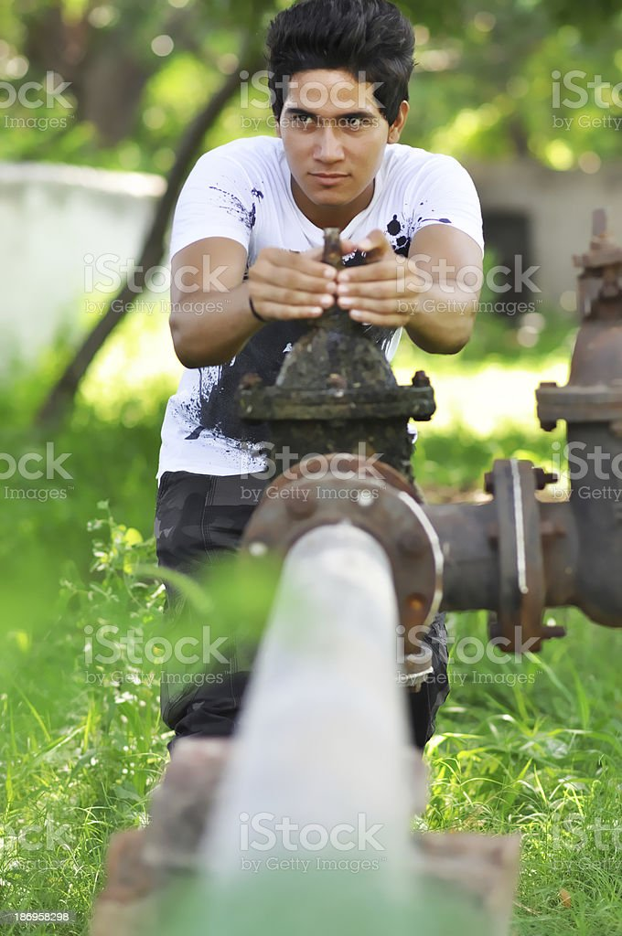 Indian man hard working in pump stock photo