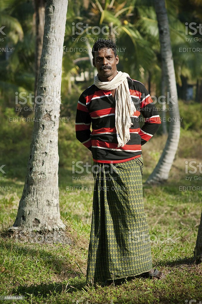 Indian man on the village footpath. stock photo