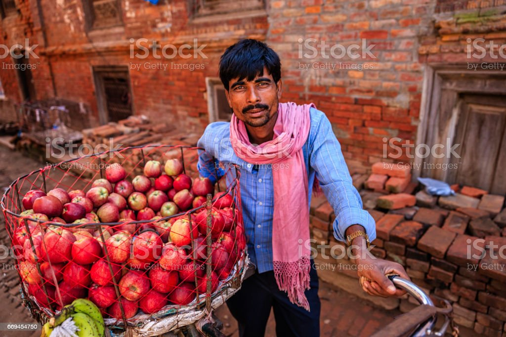 Indian man selling fresh apples on the street, Bhaktapur stock photo